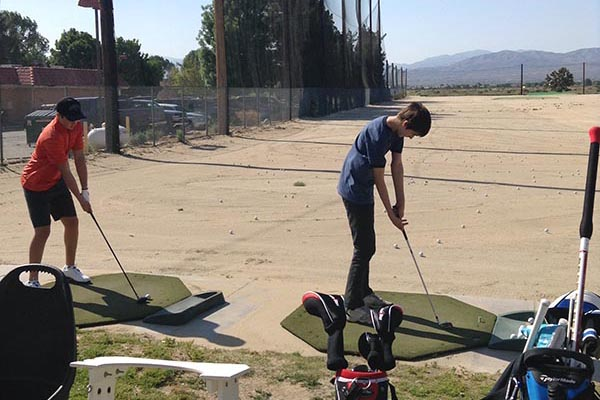 Young golfers practicing